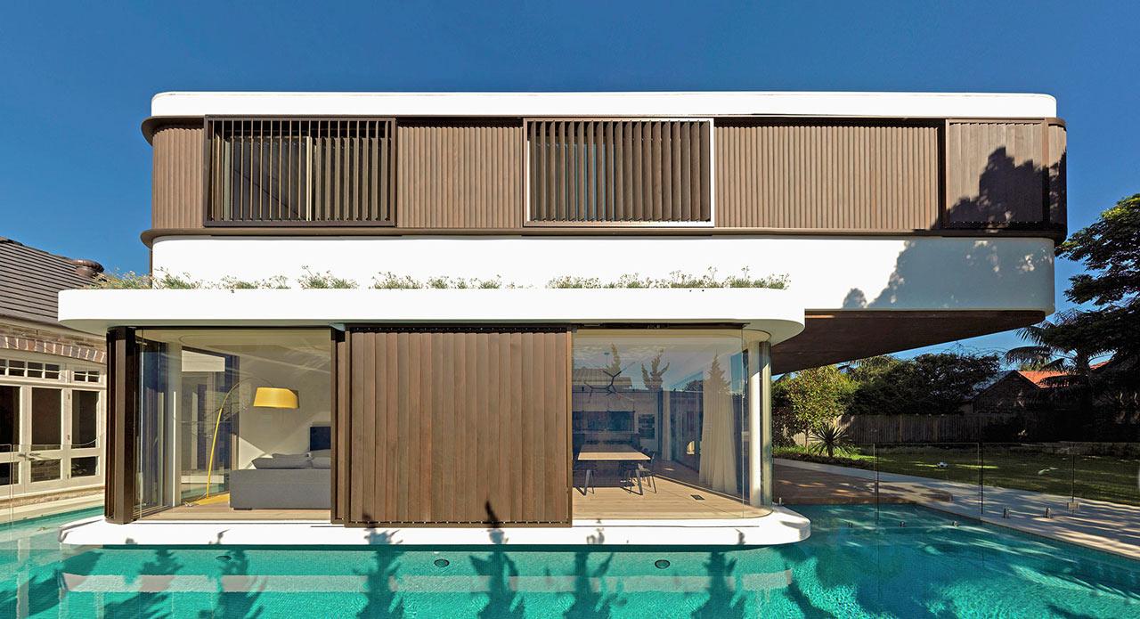 Linda casa moderna com piscina em toda a volta 2 enjoy for Casa moderna piscina