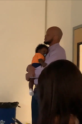 Professor Helps Student To Calm Crying Baby During Lecture As He Continue Teaching