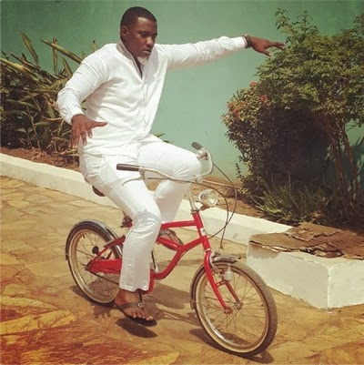 john dumelo riding a bike