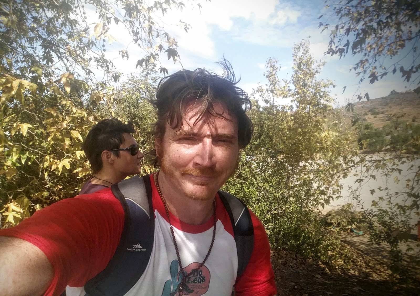 White guy sweat from hiking takes a selfie