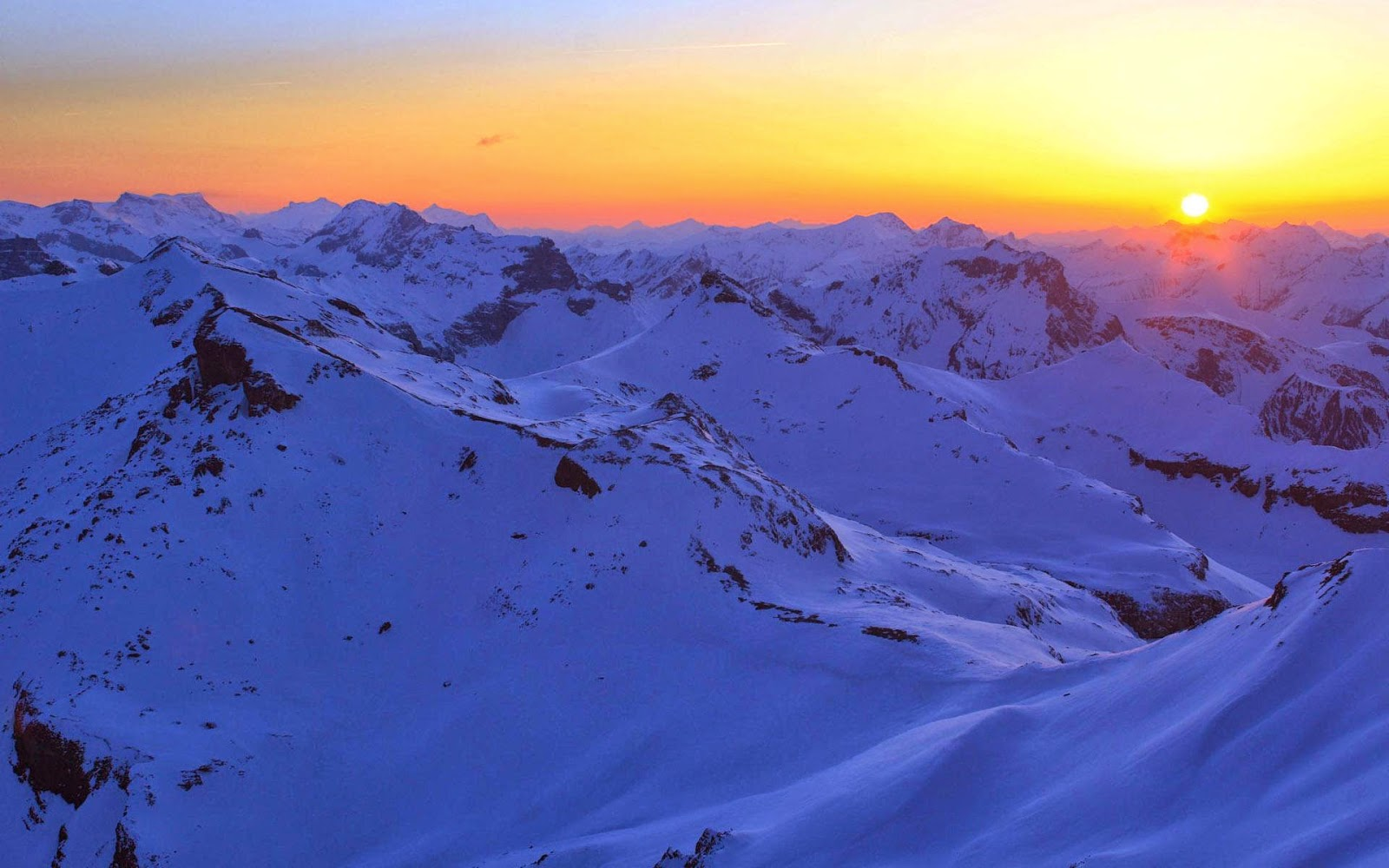 sunset-over-snowy-mountains-beautiful-nature-images-wallpapers