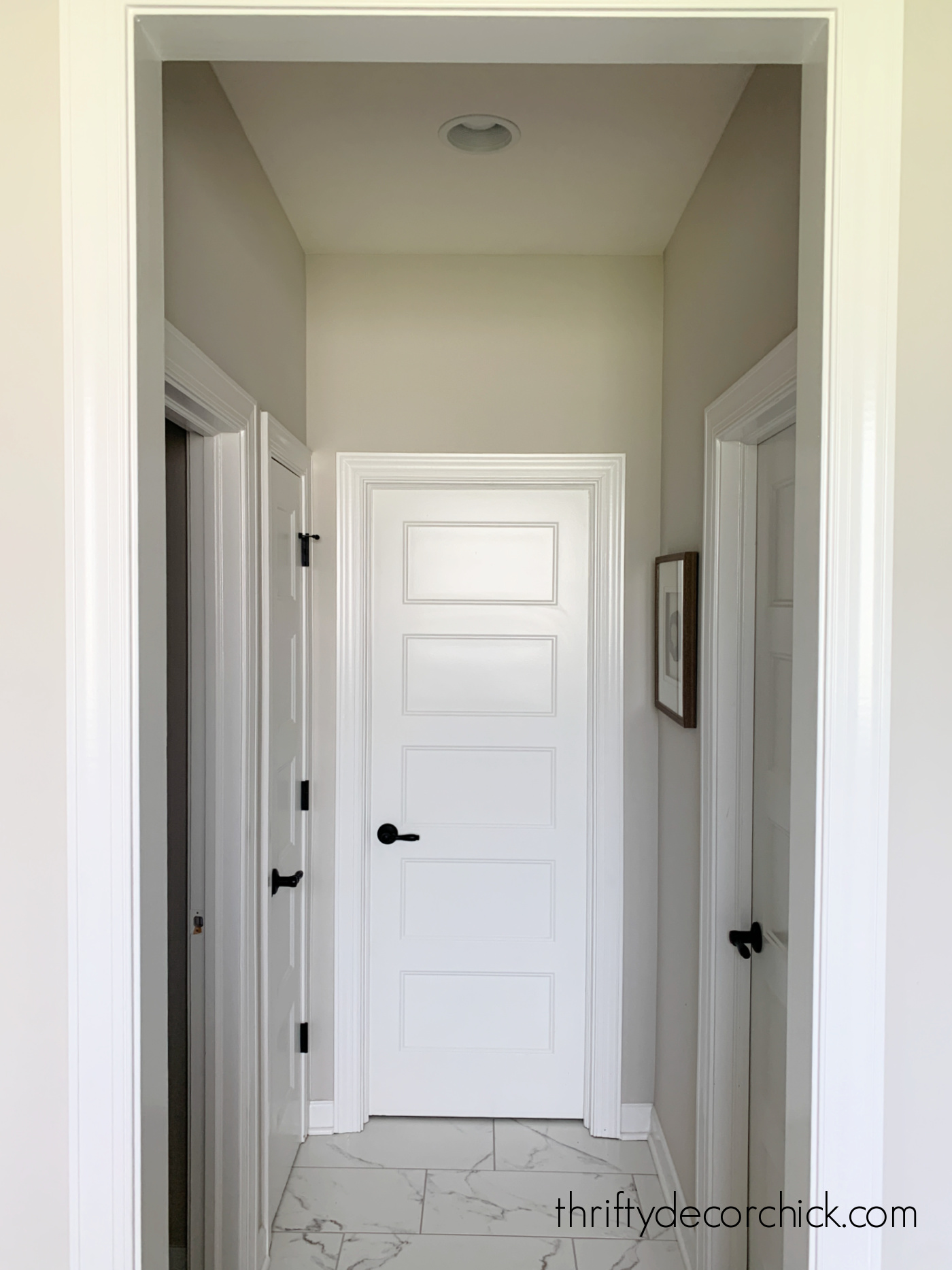 small hallway with marble tile