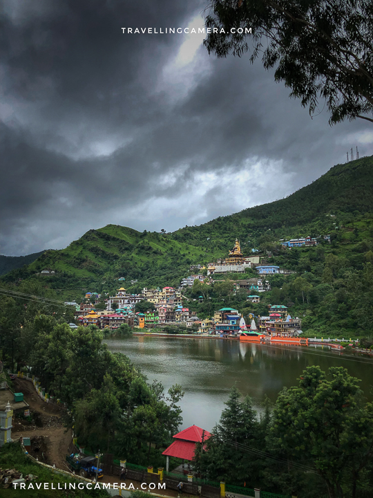 """Above photograph is clicked from Gurudwara at Rewalsar and offers a view of Rewalsar Lake. And on the top of the hill you can easily see this huge statue of Padamsambhava.  Rewalsar lake is in Mandi district of Himachal Pradesh. Mandi town comes on the way when you go to Kull/Manali from Chandigarh or Delhi.   Like many other places, Rewalsar is approachable through road. Nearest Railway station is Una and nearest airport is in Bhutar/Kullu. For road trip to Rewalsar, Google Map is best to follow than we sharing details, but keep in mind that it's a little away from main highway which connects Delhi with Mandi.  Lot of people come to Rewalsar from Mandi town, which means they stay around Mandi town and plan a day trip to Rewalsar.    This  statue of Padmasambhava at Rewalsar is 12 meter high and also known as Guru Rinpoche, which was installed in 2012 by Dalai Lama. When my niece looked closely at the statue, her question was - """"Why Padamsambhava is sitting with 'yo 🤟' pose?"""". I couldn't the question well and then she asked me to look at the hands of Padamshambhava and then I realised what she means :)."""