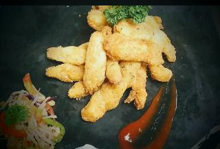 Garnished fish fingers with sprouts salad and sauce for fish finger recipe