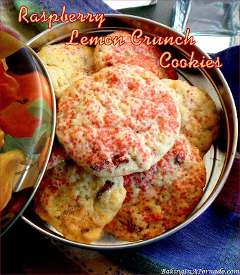 Raspberry Lemon Crunch Cookies, a sweet lemony snack, start with a cookie mix, add a few ingredients, roll in sugar and bake.   Recipe developed by www.BakingInATornado.com   #recipe #cookies