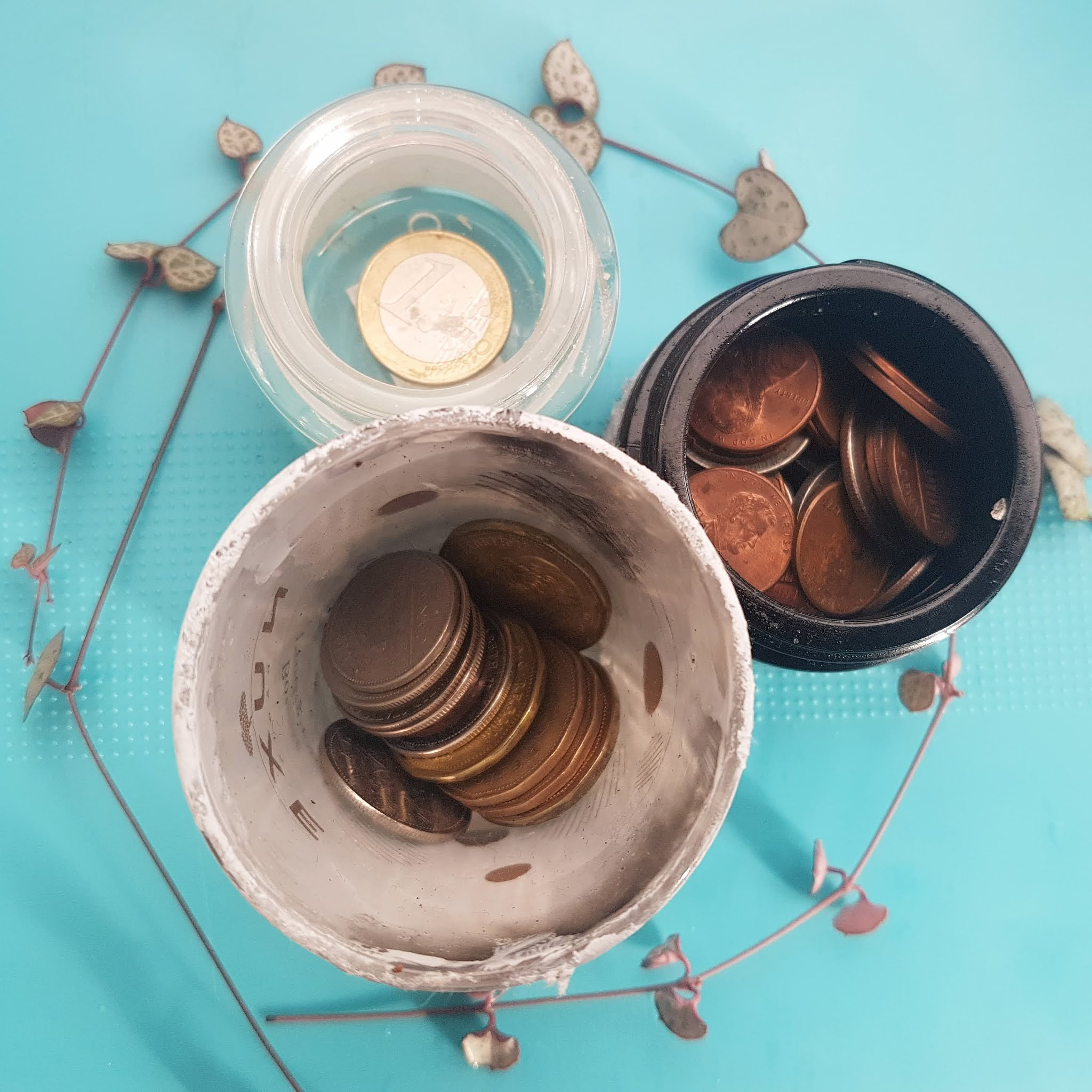 Candle votives repurposed into storage containers, upcycled money holders to separate foreign currencies