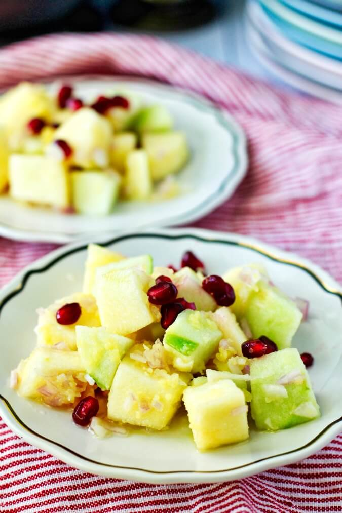 Plates of Apple salad with onions, lime, honey, and olive oil