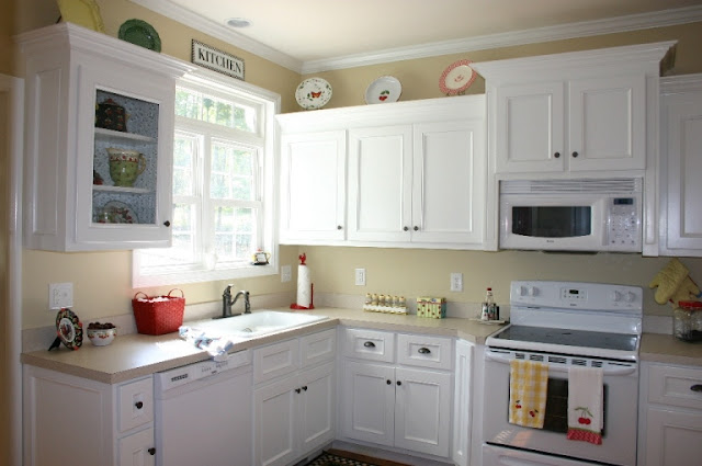white painted kitchen cabinets with oven ideas