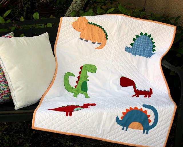 Jude Harbor applique dinosaur baby quilt