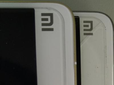 Perbedaan Logo Xiaomi Asli Dan Xiaomi Palsu