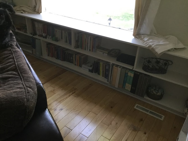 Built in shelving below the window