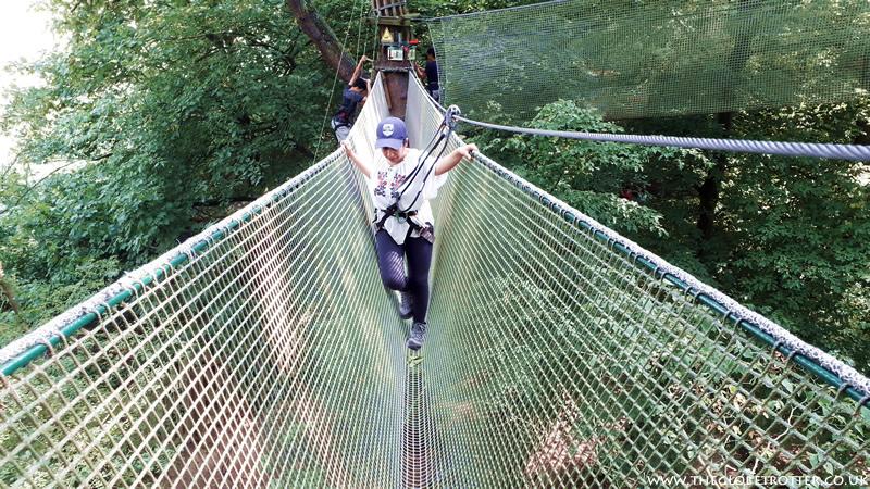 Crossing the rope bridge - Go Ape Cockfosters