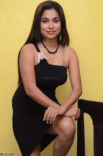 Vrushali Gosavi in strapless Short Black Dress At Follow Follow U Audio Launch 040.JPG