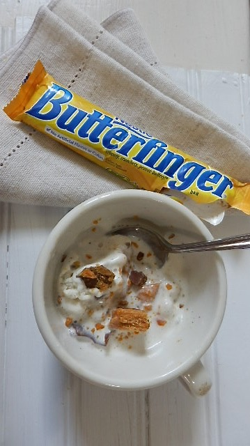 Butterfinger bits and vanilla ice cream