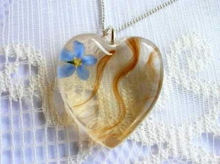 Hair and forget me not flower pendant