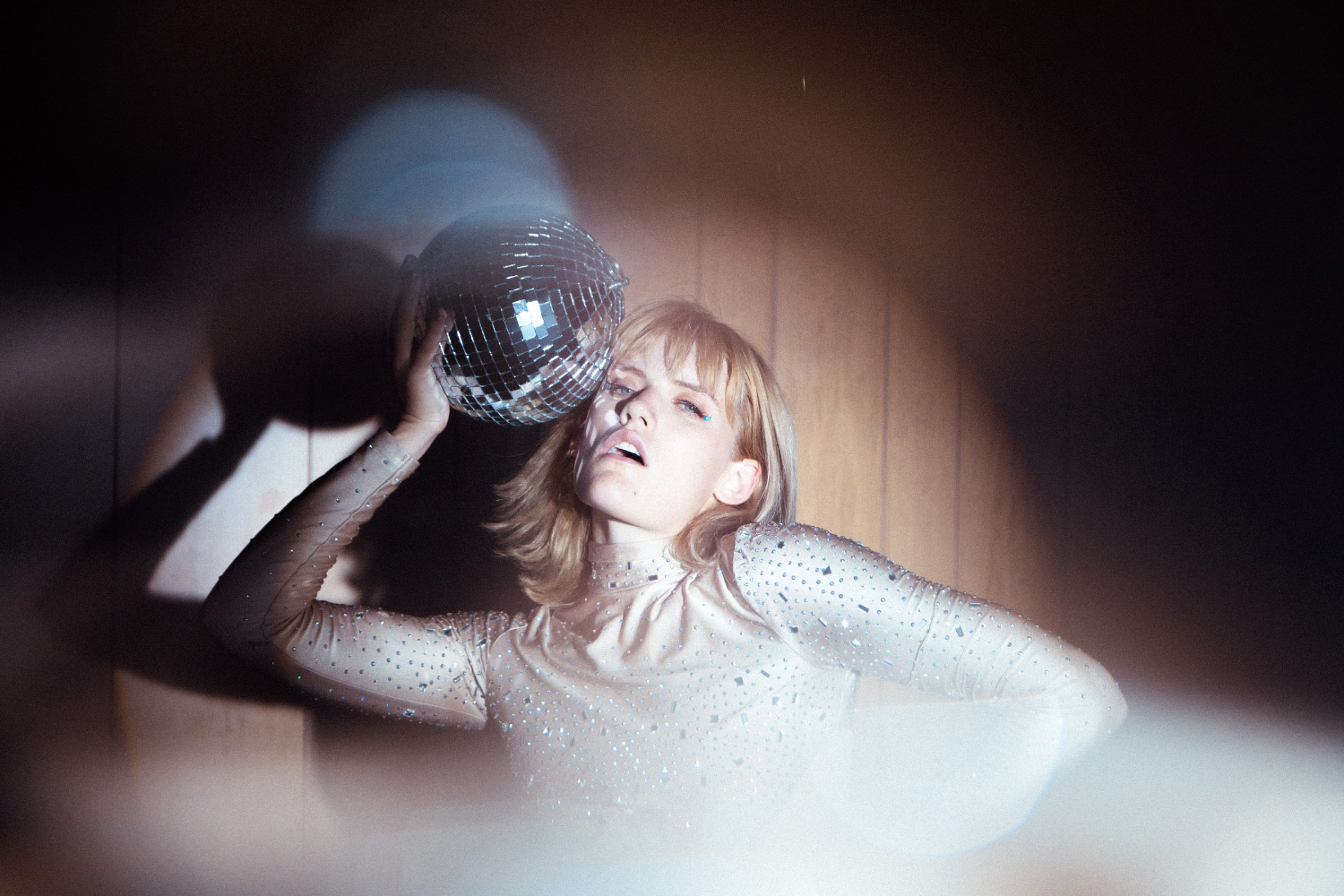 woman is posing with disco ball