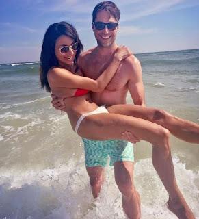 Picture of Carlo Marks carrying his girlfriend Shivani Ruparelia