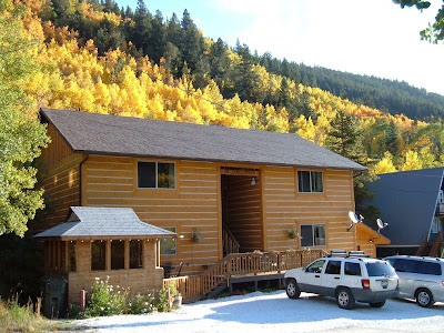 Exterior photo of condos with fall colors on the Aspen Trees all around.