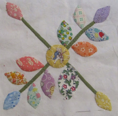pink orange blue applique leaves from quilting at the farm