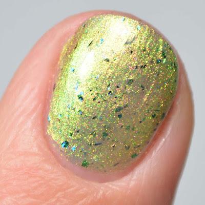 green shimmer nail polish close up