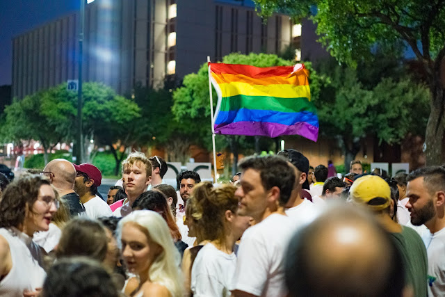 A rainbow flag flying at the San Antonio PRIDE Parade