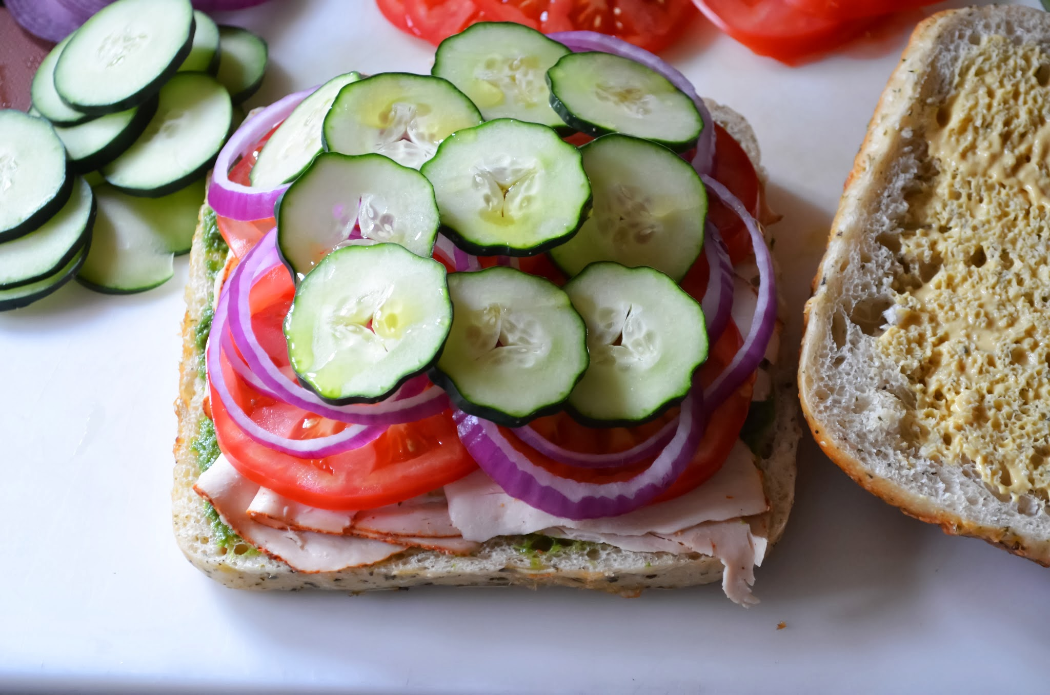 Sliced Cucumbers on top of red onions.