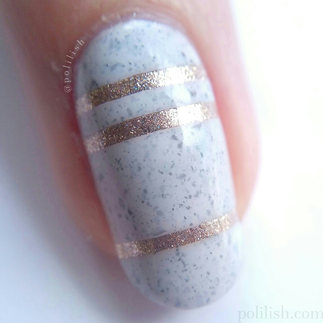 Close-up of striped nails with Cirque Colors 'Hatch' and 'Cin Cin' from the Speckled and Sparkled collection