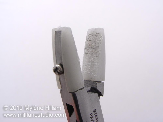 Nylon jaw pliers with hacked up nylon sleeves