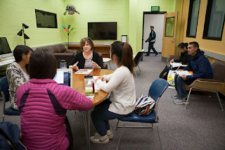 Professor Trish Grega works with students during a group coaching session at the Academic Coaching Center, located in the Learning Resources Center at Sally Monserud Hall. (Photo by Philip Hall/UAA)