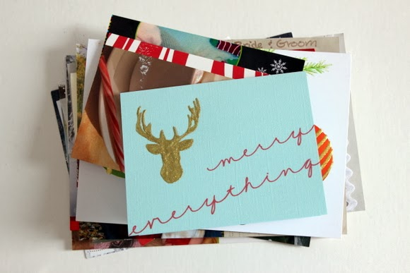 I like to stack up the Christmas Cards by size before I make them into a book. It's so much neater that way.