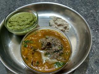 Sprouted Black eyed pea steamed vada in Pumpkin sambhar,  Mint chutney, Coconut chutney