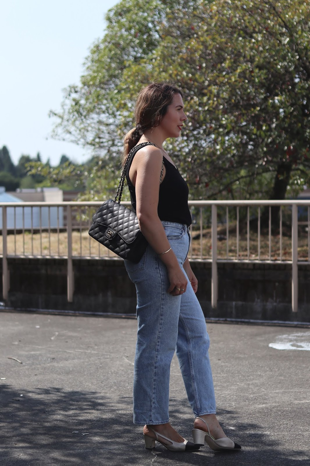 90s outfit idea 2019 levis dad jeans blogger chanel jumbo bag aleesha harris