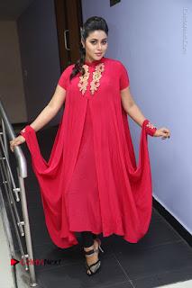 Actress Poorna Latest Stills in Red Dress at Rakshasi First Look Launch  0301.JPG