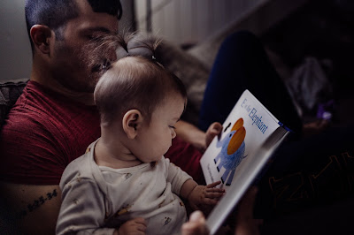 In home lifestyle Family imagery of Father and Daughter reading book together photogrpahed by Morning Owl Fine Art Photography San Diego.