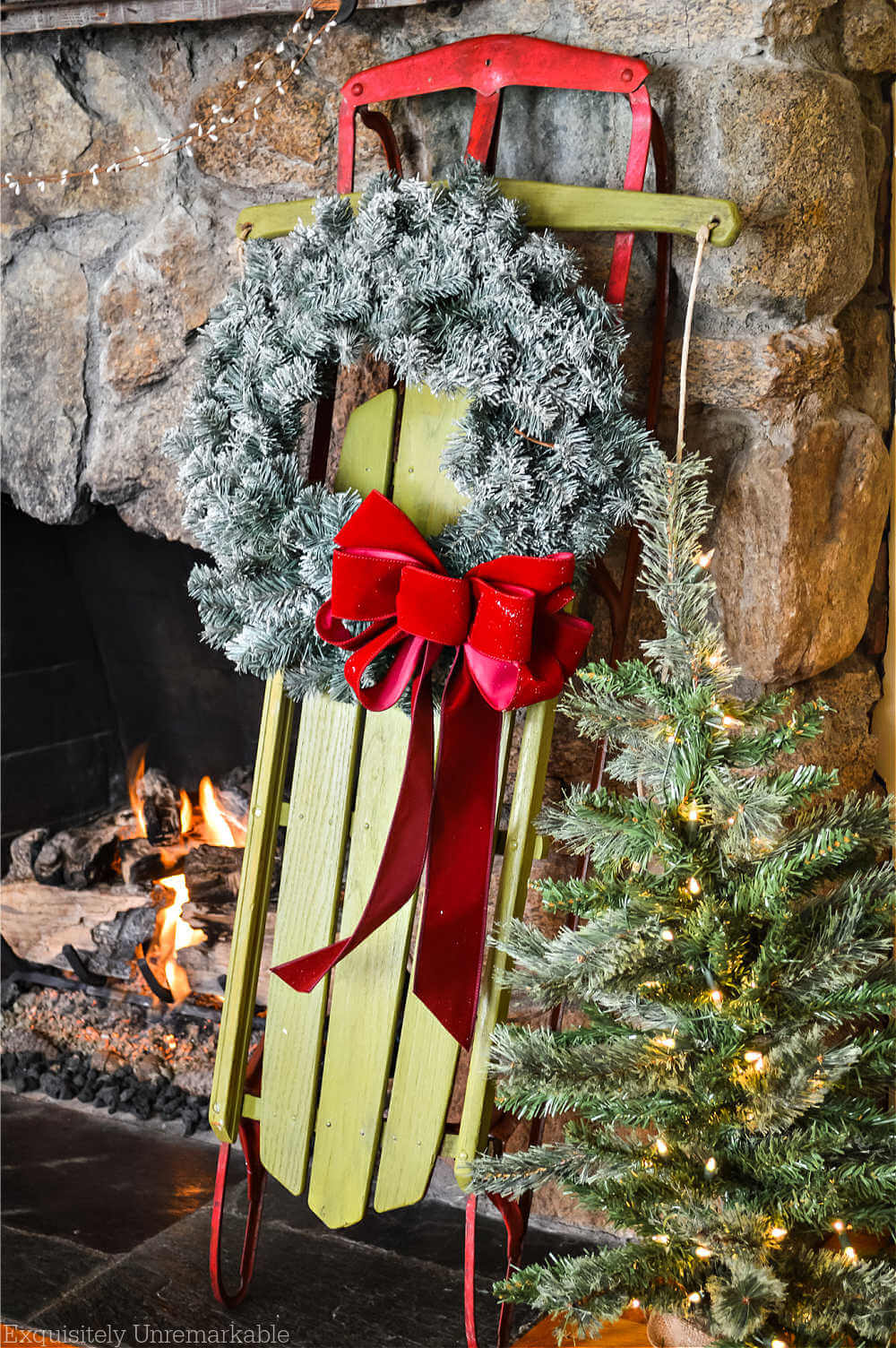 DIY Green and Red Christmas Sled next to the fireplace
