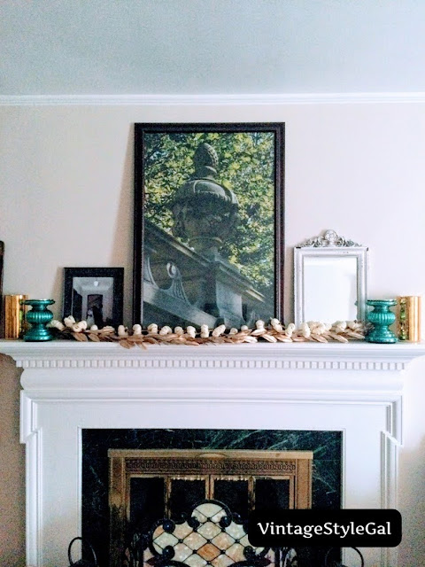 Added in teal candle sticks on either end of mantel