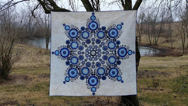 Flurry snowflake quilt made with circles