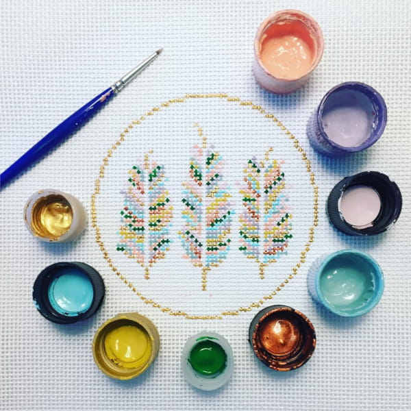 3 pastel feathers in a circle needlepoint design