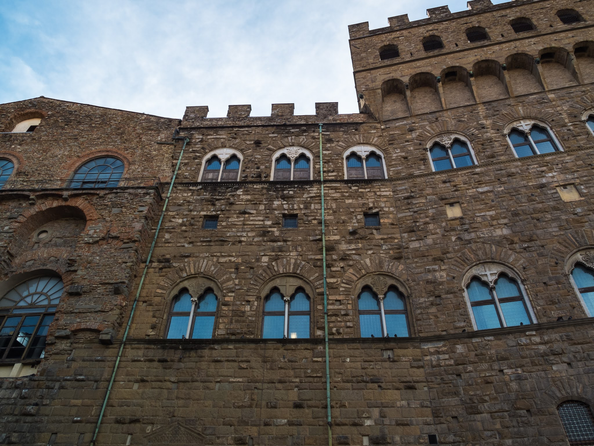 Looking up at the exterior of the Palazzo Vecchio in Florence.