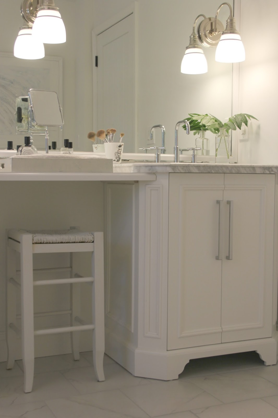 White vanities with carrara marble tops and Kohler Purist bathroom faucets. Come see renovation photos in Before & After: My Home Renovation.