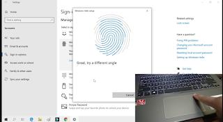 komputer yang terintegrasi dengan sensor fingerprint