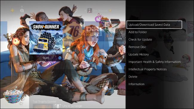"""حدد """"تحميل / تنزيل البيانات المحفوظة"""" على شاشة PS4 الرئيسية."""