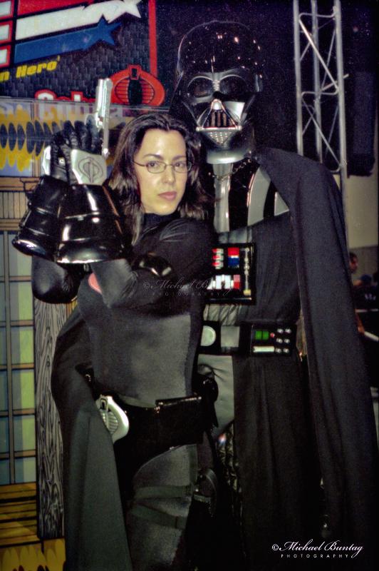 G.I. Joe  Baroness, Star Wars Darth Vader/Anakin Skywalker cosplayer, Comic-Con International, San Diego Convention Center, Marina District, San Diego, California. Kodak 160VC color negative 35mm film.