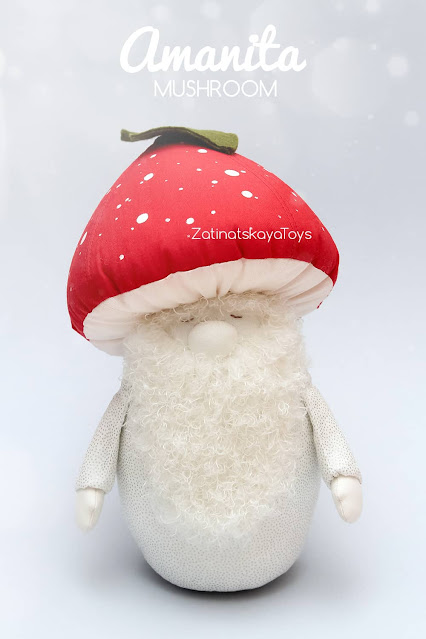 Christmas gnome with closed eyes and a red mushroom hat by sewing patterns of Zatinatskaya Natalia