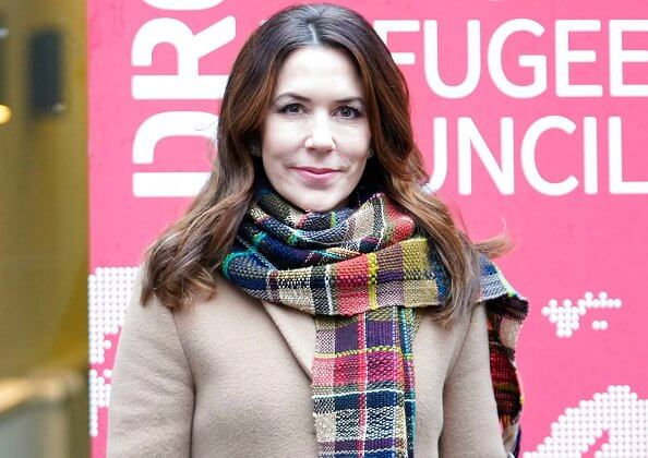 Crown Princess Mary wore a flared long coat from Max Mara, and black silk shirt. Handmade scarf crocheted-rainbow colors scarf
