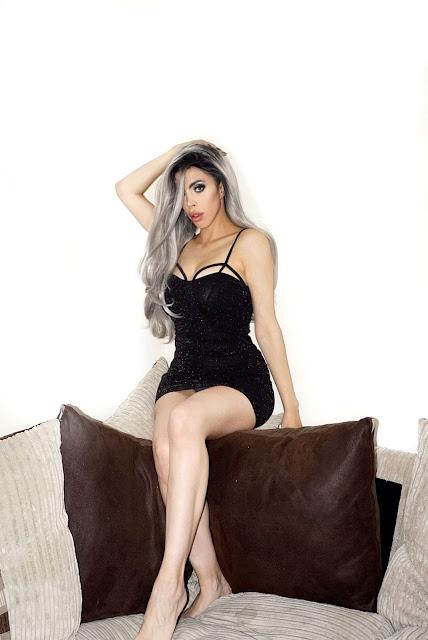 Femme Luxe Black Glitter Cut Out Cup Strappy Bodycon Mini Dress in model Dottie