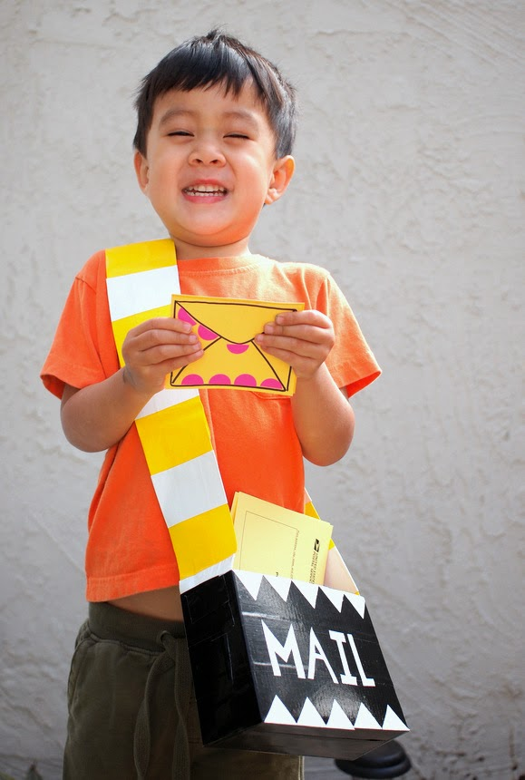 boy wearing homemade mailbag