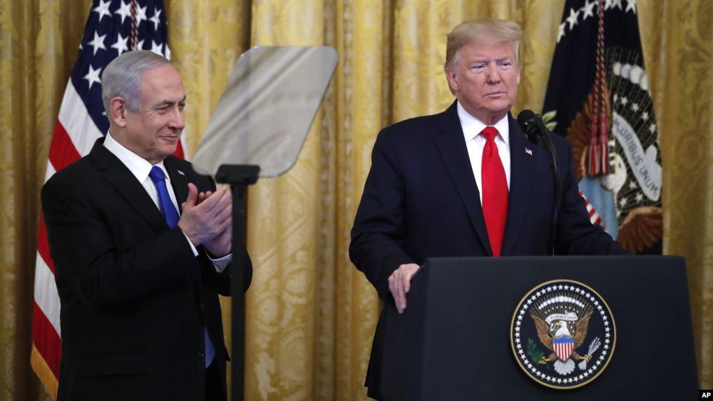 El presidente Donald Trump anuncia su plan de paz para el Oriente Medio junto al primer ministro israelí, Benjamin Netanyahu, en la Casa Blanca en Washington el martes, 28 de enero de 2020 / AP