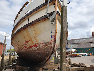 Photo of an old boat in dry dock for repairs
