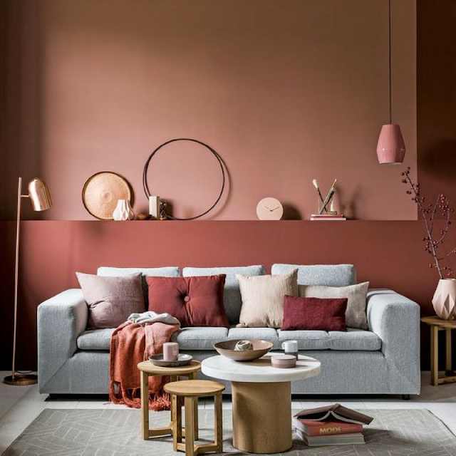 Pink wall behind the sofa • the round button blog